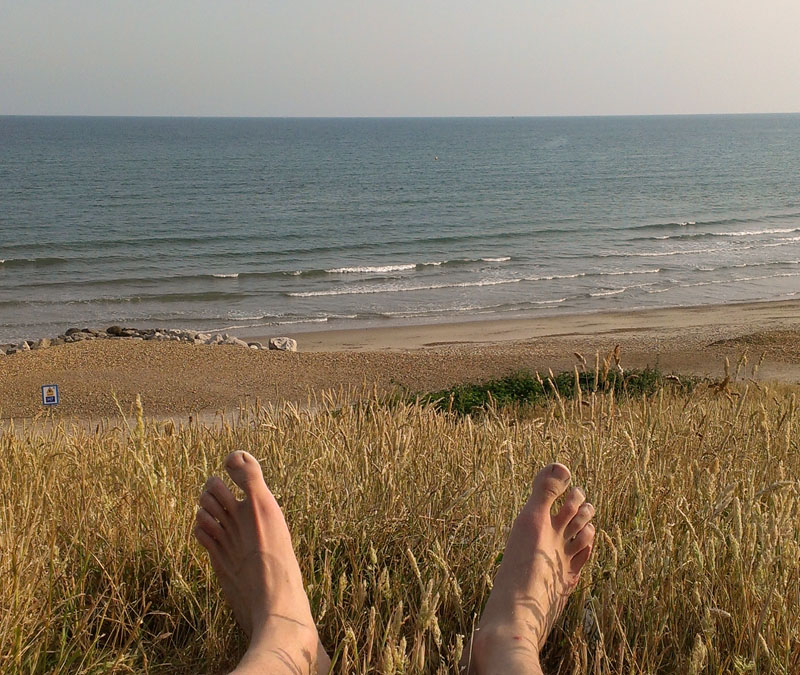 Taking a break from barefoot running to enjoy the sea views on the south coast